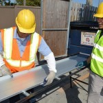metal roofing workers rollforming